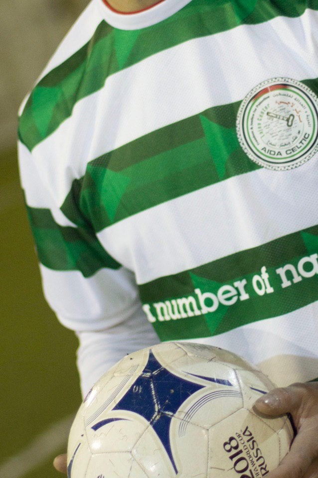 person wearing aida celtic football top